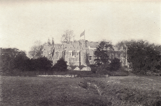 Black and white photograph of Berkeley Castle in England, taken in the late 19th century.
