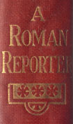 Gilt title, A Roman Reporter on the maroon spine of the book, with three gilt round floral emblems in a row, underneath the title.