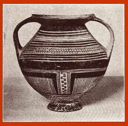 Black and white photograph of a decorated clay Peucetian krater, or vase, with two handles.