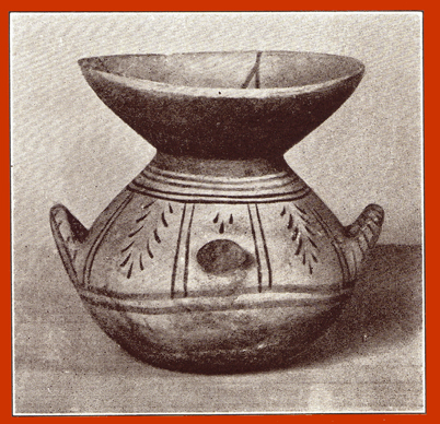 Black and white photograph of a decorated clay Daunian krater, or vase, with two small handles and a large mouth.
