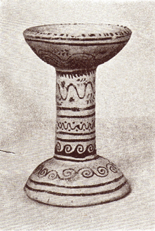Black and white photograph of a decorated clay incense burner.