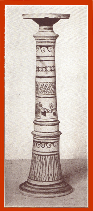 Black and white photograph of a taller decorated clay incense burner.
