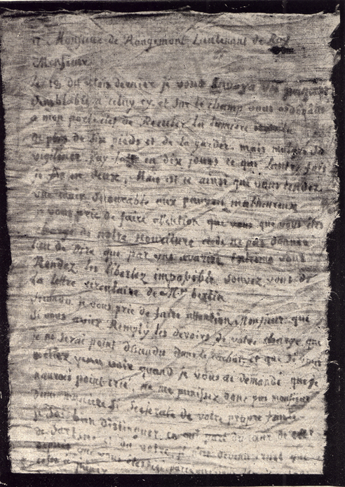 A black and white picture of the start of a letter written with blood on linen by Latude, to Rougemont.