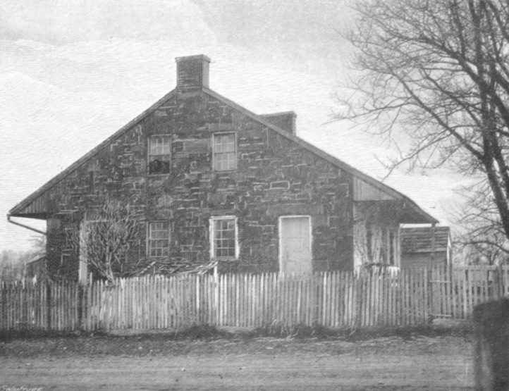 Black and white photograph of a small A-Frame two story house, surrounded by a picket fence, near Cashtown, Lee's headquarters.