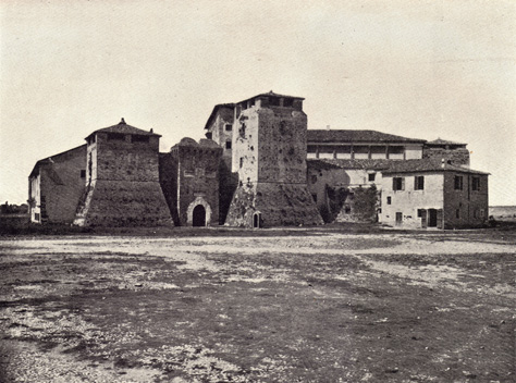 Black and white photograph of Rocca Malatestiana in Rimini, Italy, thirteenth century on a treeless landscape, taken in the late 19th century.