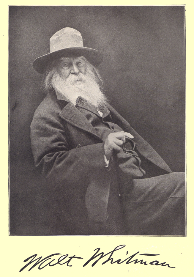 A black and white photograph of Walt Whitman.  He is seated, with a long white beard, suit and hat.  An autograph,  his signature, in his own writing, is below the portrait.