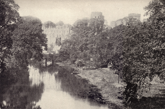 Black and white photograph of Warwick Castle, England, seen in the distance, with trees and a river in the foreground, taken in the late 19th century